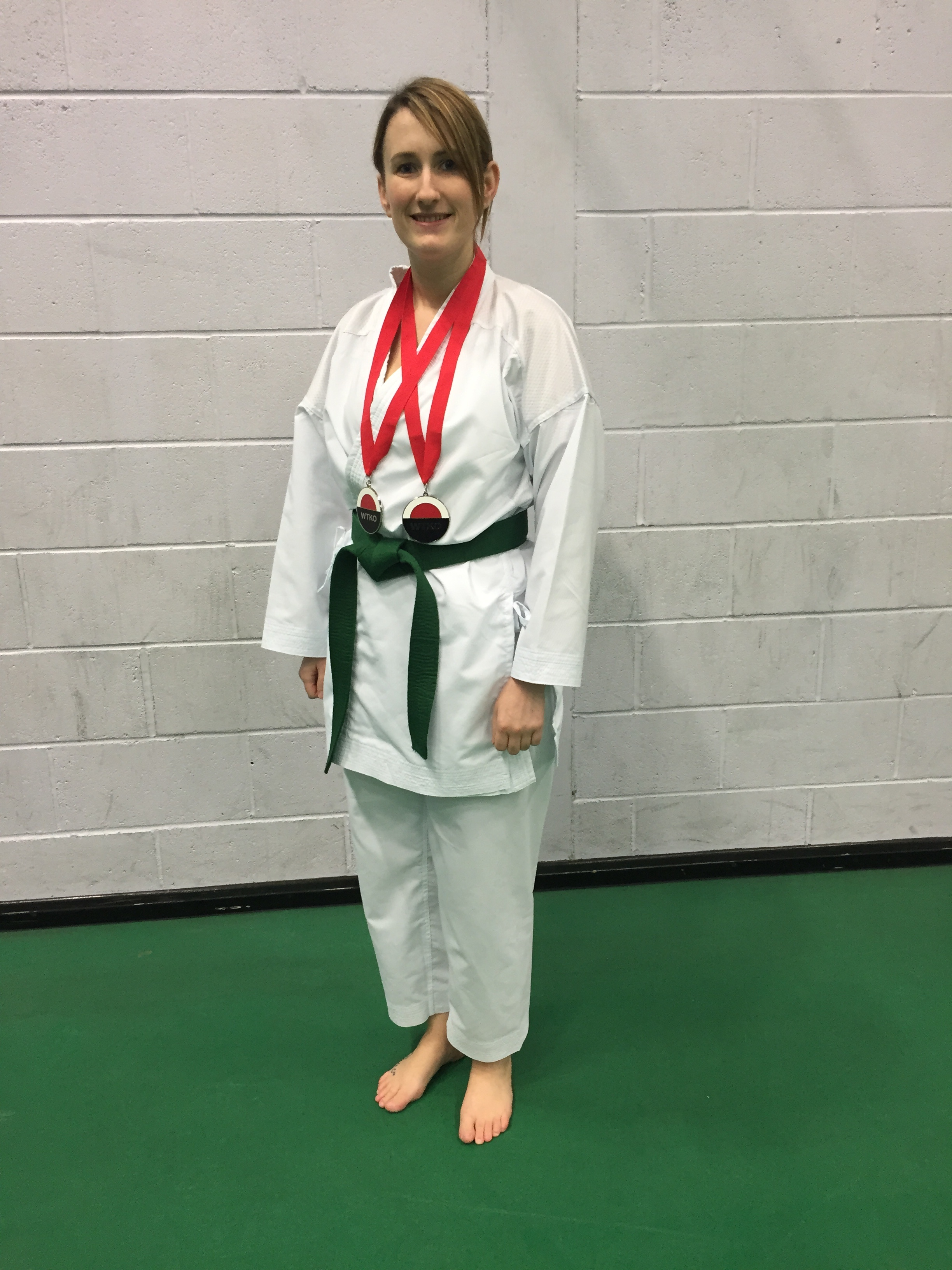 Kirsty with two silver medals from WKTO Nationals